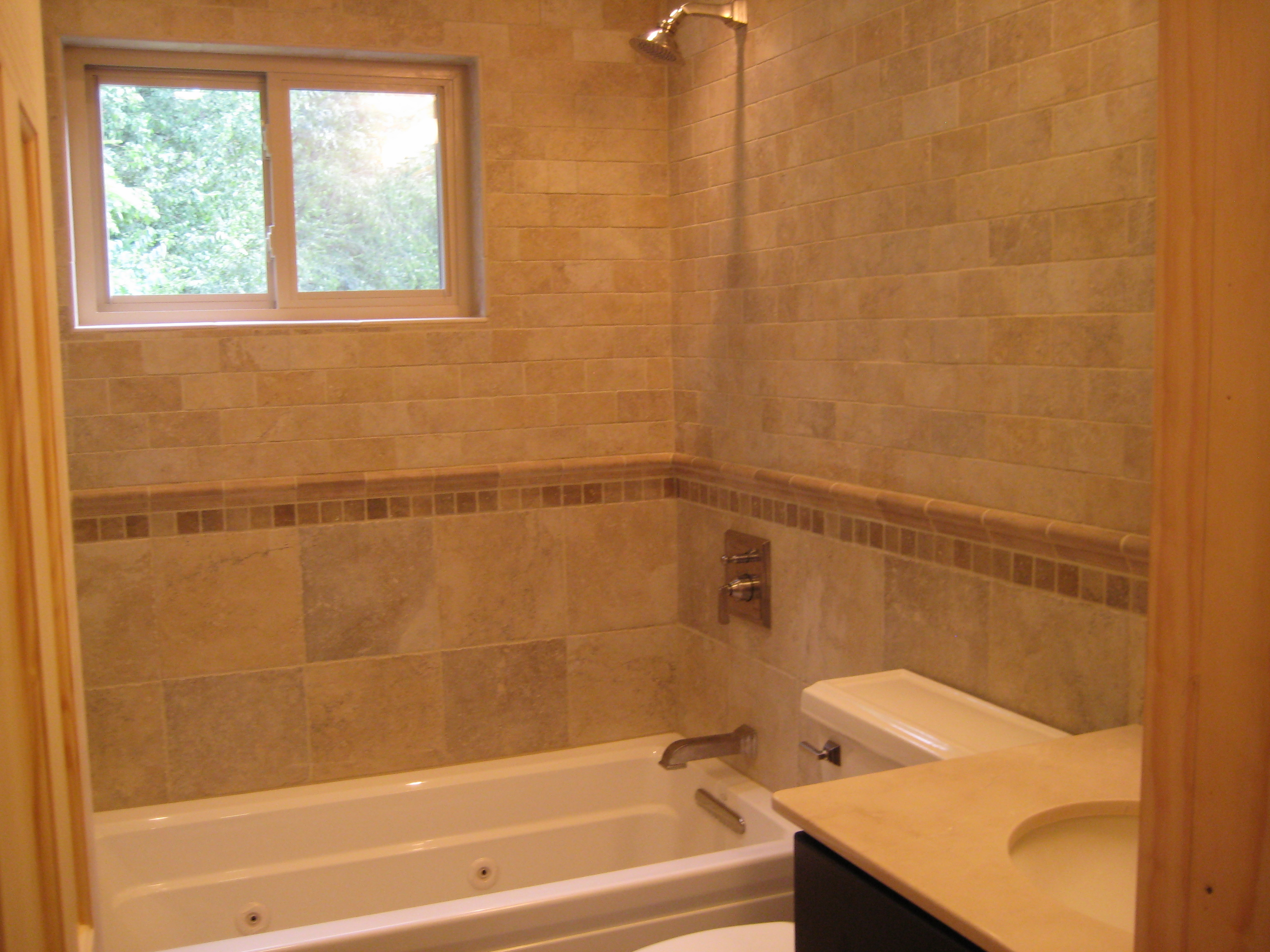 Bathroom remodel hire her home improvements inc for Show me pictures of remodeled bathrooms